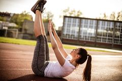 Workout your abs. Young woman exercise. Close up image. Beautiful young sports woman Stock Images