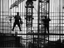 Workpeople. Construction site, evening, workers assemble the elements of the building structure Royalty Free Stock Photography