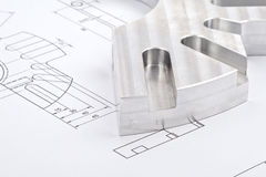 Workpiece on a blueprint Stock Images