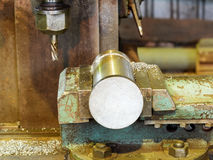 Workpiece and drill of boring machine close up Royalty Free Stock Photos