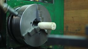 Workpiece in headstock of turning lathe machine stock video footage