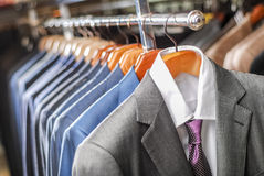 Workpiece jackets on clothes hanger in tailoring studio Stock Photo