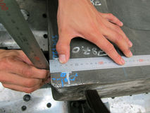 Workpiece and steel rule Stock Images