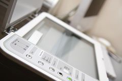 Workplace with all-in-one printer. Scanner, copier. Control view close-up. Shallow DOF Stock Images