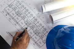 Workplace of architect - Architect rolls and plans.architectural plan,technical project drawing. Engineering tools view from. The top. Construction background stock photography