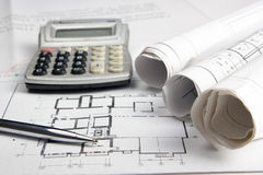 Workplace of architect - Architectural project, blueprints, rolls and calculator, pen on plans. Engineering tools view Stock Photo