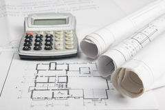 Workplace of architect - Architectural project, blueprints, rolls and calculator on plans. Engineering tools view from Royalty Free Stock Photo