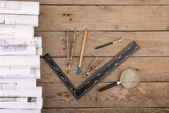 Workplace of architect - construction drawings and tools. On the wooden desk Stock Photos