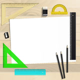Workplace art board, paper, ruler, protractor, pencils Stock Images