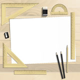 Workplace art board, paper, ruler, protractor, pencils Stock Photography
