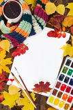 Workplace of artist. Sheet of paper, paints, brushes and autumn Royalty Free Stock Images