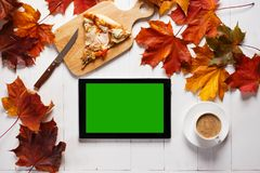 Workplace in autumn style concept. Tablet and lunch on wooden desk. Top view stock image