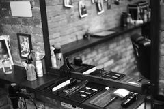 The workplace of the barber. Tools for a hairstyle. Black and white image royalty free stock image