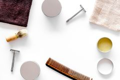 Workplace in barbershop. Razor, shaving brush, comb on white background top view copyspace Stock Photography