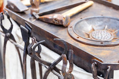 Workplace blacksmith with tools and products Stock Image