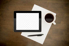 Workplace With Blank Digital Tablet. Blank digital tablet with paper, pen and cup of coffee on worktable Royalty Free Stock Image