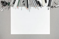 Workplace with blank sheet of paper and various drawing tools Stock Photography