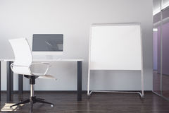 Workplace and blank whiteboard. Modern interior with workplace and blank whiteboard stand. Mock up, 3D Rendering Royalty Free Stock Image