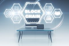Workplace with blockchain hologram. Workplace with creative blockchain hologram. 3D Rendering Stock Photo