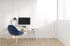 Workplace with a blue chair. A wooden desk and a computer standing under a large window. 3d rendering, mock up Stock Photos
