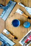 Workplace of builder with instruments and paint on wooden background top view Stock Photos