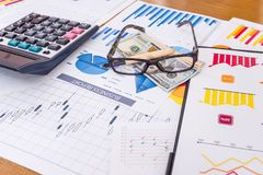Workplace of business analyst, graphs and diagrams on table.  stock images