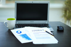 Workplace with business diagrams. Laptop, financial report in cooperation royalty free stock photography