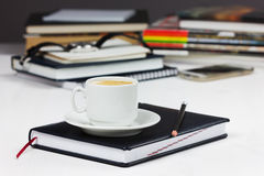 Workplace with business diary, pencil and cup of coffee break Stock Photography