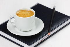 Workplace with business diary, pencil and cup of coffee break. Royalty Free Stock Photo