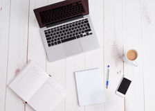 Workplace business. laptop, coffee, pen notebook Stock Image