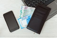 The workplace of business people. Laptop and money. Payment by Bank card. stock photography