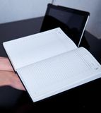 Workplace business person. Diary, on the background of the phone and tablet Stock Photography