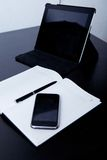 Workplace business person: diary. On the background of the phone and tablet Royalty Free Stock Image