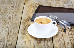 Workplace businessman: laptop, coffee and sunglasses Stock Photo