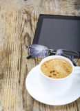 Workplace businessman: laptop, coffee and sunglasses Royalty Free Stock Images