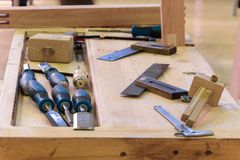 Workplace carpenter, workbench with a variety of carpentry tools. Manual woodworking Stock Image