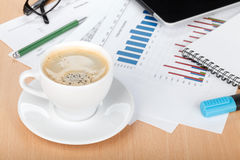 Coffee cup on workplace Stock Image