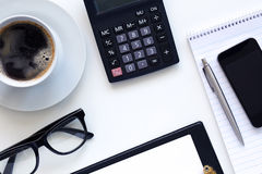 Workplace, coffee and diary with calculator Stock Images
