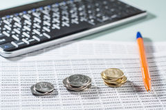 Workplace with coins, documents, keyboard and pen. Stock Images