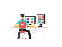 Workplace concept. Man sitting at the desktop and working. Stock Images