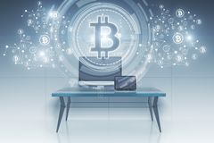 Workplace with bitcoin hologram. Workplace with creative bitcoin hologram. 3D Rendering Stock Photos
