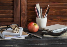 Free Workplace Designer And Architect With Business Objects - Books, Notebooks, Pens, Pencils, Rulers, Tablet, Glasses And A Model Of A Stock Image - 64650391