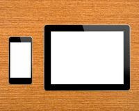 Workplace with digital tablet computer. Tablet pc and modern smartphonewith blank screen over table Royalty Free Stock Images