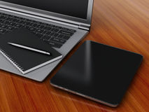 Workplace with digital tablet, laptop pc and notepad with pen. Royalty Free Stock Images