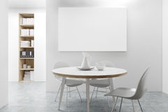 Workplace dining area, poster. Workplace dining area with a round table, a bookcase in the background and a horizontal poster. 3d rendering, mock up Royalty Free Stock Image