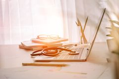 Workplace of doctor with laptop and stethoscope on table in the. Hospital Stock Photography