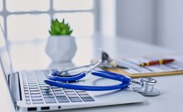 Workplace of the doctor in the office Stock Images