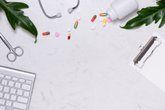 Workplace of a doctor. Stethoscope, clipboard, pills and other s stock photography