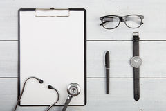Workplace of doctor - stethoscope, medicine clipboard, glasses a Stock Photo