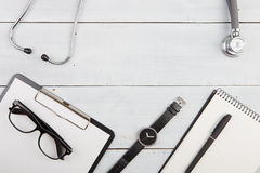 Workplace of doctor - stethoscope, medicine clipboard, glasses a Stock Image